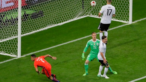 Chile's Alexis Sanchez, left, reacts after scoring during the Confederations Cup, Group B soccer match between Germany and Chile, at the Kazan Arena, Russia, Thursday, June 22, 2017. (AP Photo/Sergei Grits)