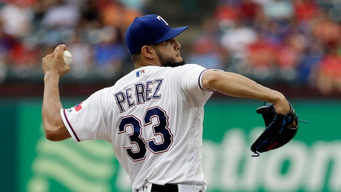 Texas Rangers starting pitcher Martin Perez throws to the Toronto Blue Jays in the first inning of a baseball game, Thursday, June 22, 2017, in Arlington, Texas. (AP Photo/Tony Gutierrez)