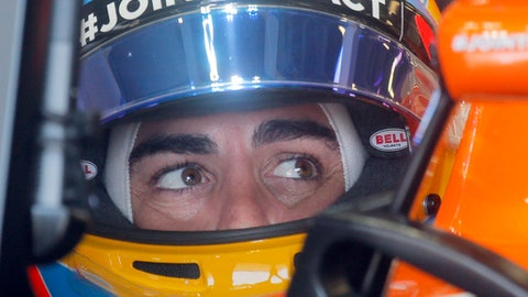 McLaren's Formula One driver Fernando Alonso of Spain enters the pitlane during the first practice session at the F1 Grand Prix circuit in Baku, Azerbaijan, Friday, June 23, 2017. The Formula One Grand Prix of Europe will be held on Sunday. (AP Photo/Efrem Lukatsky)