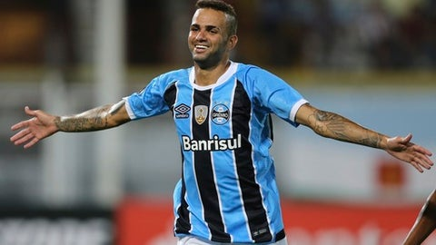 FILE - In this March 9, 2017 file photo, Luan of Brazil's Gremio celebrates after scoring against Venezuela Zamora during a Copa Libertadores soccer match in Barinas, Luan  is yet to play abroad and his coach has already said it will be hard to keep him in Brazil until the end of the season. After eight matches, Luan scored four goals. His playmaking skills have put him as the best in the tournament so far. (AP Photo/Fernando Llano, File)