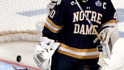 Notre Dame goalie Cal Petersen gives up a goal to Denver's Emil Romig during the first period of an NCAA Frozen Four men's college hockey semifinal, Thursday, April 6, 2017, in Chicago. (AP Photo/Nam Y. Huh)