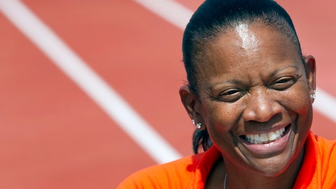FILE - In this March 31, 2011, file photo, Texas women's head track and field coach Beverly Kearney smiles during practice in Austin, Texas. The Texas Supreme Court has refused to block a sex and race discrimination lawsuit filed against the University of Texas by former women's track coach Bev Kearney, who was forced out after the school learned of a romantic relationship with one of her athletes a decade earlier. (Ralph Barrera/American-Statesman via AP, File)