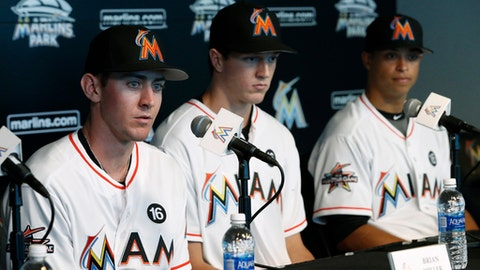 Miami Marlins' top three draft picks, Brian Miller, left, Trevor Rogers, center, and Joe Dunand speak during a news conference Friday, June 23, 2017, in Miami. The Marlins have agreed to minor league contracts with the three, reaching a deal with No. 13 overall selection Rogers that includes a $3.4 million signing bonus. (AP Photo/Wilfredo Lee)