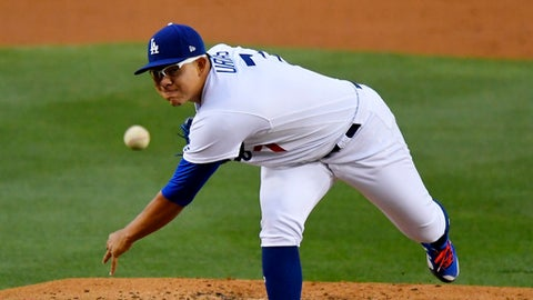 FILE - In this May 9, 2017, file photo, Los Angeles Dodgers starting pitcher Julio Urias throws during the team's baseball game against the Pittsburgh Pirates in Los Angeles. Urias, the Dodgers' top prospect, needs shoulder surgery and will miss the rest of the season. The 20-year-old is scheduled to have his left anterior capsule repaired Tuesday, June 27. (AP Photo/Mark J. Terrill, File)