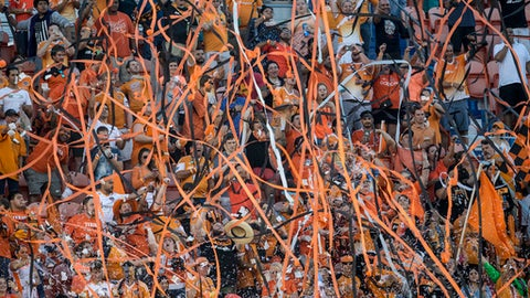 Houston Dynamo fans throw streamers and confetti before an MLS soccer match between the Dynamo and FC Dallas on Friday, June 23, 2017, in Houston. (Brett Coomer/Houston Chronicle via AP)