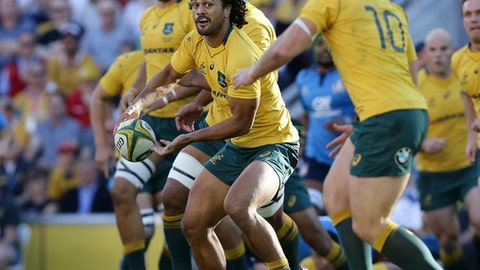 Karmichael Hunt of Australia prepares a pass during an international rugby match between Australia and Italy in Brisbane, Australia, Saturday, June 24, 2017. (AP Photo/Tertius Pickard)