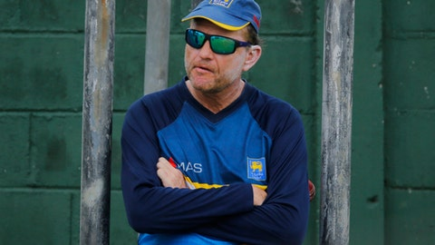FILE - In this Tuesday, March 14, 2017 file photo, Sri Lankan cricket team coach Graham Ford watches his team members during a practice session prior to their test cricket match against Bangladesh in Colombo, Sri Lanka. Sri Lanka Cricket announced on Saturday June 24, 2017, Graham Ford is stepping down as head coach of Sri Lanka's cricket team, ending his second spell in charge after 18 months. (AP Photo/Eranga Jayawardena, File)