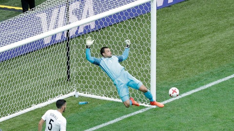 New Zealand goalkeeper Stefan Marinovic makes a save during the Confederations Cup, Group A soccer match between New Zealand and Portugal, at the St. Petersburg Stadium, Russia, Saturday, June 24, 2017. (AP Photo/Dmitri Lovetsky)