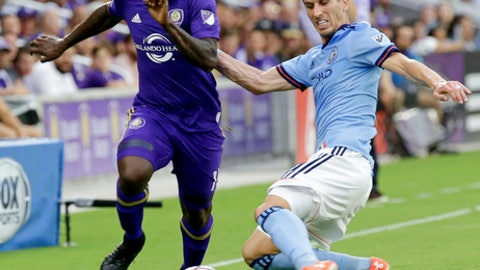 New York City FC's Ben Sweat, right, tries to get the ball away from Orlando City's Carlos Rivas during the first half of an MLS soccer game, Sunday, May 21, 2017, in Orlando, Fla. (AP Photo/John Raoux)