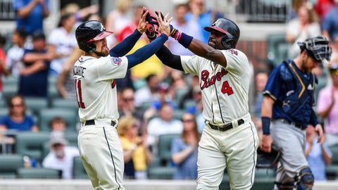 Atlanta Braves second baseman Brandon Phillips, right, high-fives Ender Inciarte, left, after hitting a two-run home run during the third inning of the team's baseball game against the Milwaukee Brewers on Saturday, June 24, 2017, in Atlanta. (AP Photo/Danny Karnik)