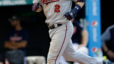 Minnesota Twins' Brian Dozier runs the bases after hitting a solo home run off Cleveland Indians relief pitcher Cody Allen in the eighth inning of a baseball game, Saturday, June 24, 2017, in Cleveland. (AP Photo/Tony Dejak)