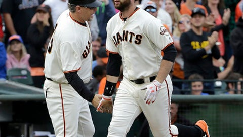 San Francisco Giants' Brandon Belt, right, celebrates with third base coach Phil Nevin after hitting a solo home run against the New York Mets during the seventh inning of a baseball game in San Francisco, Saturday, June 24, 2017. (AP Photo/Jeff Chiu)