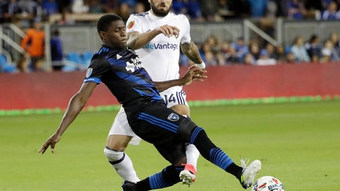 San Jose Earthquakes defender Kofi Sarkodie, front, defends a shot by Real Salt Lake forward Yura Movsisyan during the second half of an MLS soccer match Saturday, June 24, 2017, in San Jose, Calif. (AP Photo/Marcio Jose Sanchez)