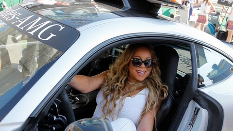 Mariah Carey poses in safety car before the Formula One Azerbaijan Grand Prix in Baku, Azerbaijan, Sunday, June 25, 2017. (AP Photo/Darko Bandic)