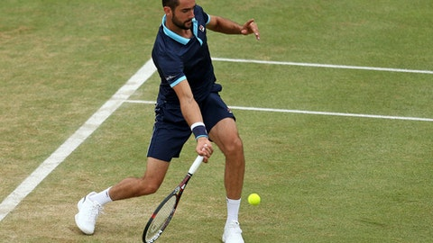Croatia's Marin Cilic in action against Spain's Feliciano Lopez during their final match at The Queen's Club tennis tournament in London, Sunday June 25, 2017. (Steven Paston/PA via AP)