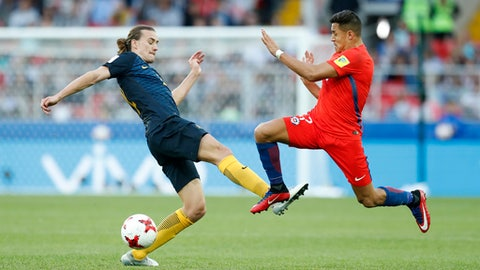 Chile's Alexis Sanchez, right, and Australia's Jackson Irvine fight for the ball during the Confederations Cup, Group B soccer match between Chile and Australia, at the Spartak Stadium in Moscow, Sunday, June 25, 2017. (AP Photo/Pavel Golovkin)