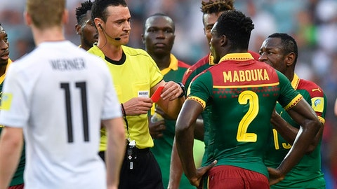 Referee Wilmar Roldan shows a red card to Cameroon's Ernest Mabouka during the Confederations Cup, Group B soccer match between Germany and Cameroon, at the Fisht Stadium in Sochi, Russia, Sunday, June 25, 2017. (AP Photo/Martin Meissner)