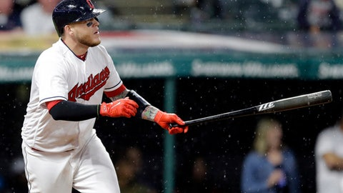 Cleveland Indians' Roberto Perez watches the ball after hitting a one-run double off Texas Rangers relief pitcher Preston Claiborne in the seventh inning of a baseball game, Monday, June 26, 2017, in Cleveland. Carlos Santana scored on the play. (AP Photo/Tony Dejak)