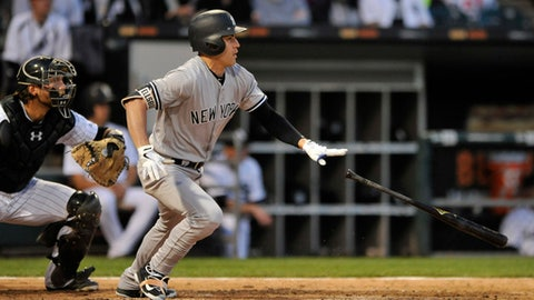 New York Yankees' Jacoby Ellsbury watches his single during the fourth inning of a baseball game against the Chicago White Sox Monday, June 26, 2017, in Chicago. (AP Photo/Paul Beaty)