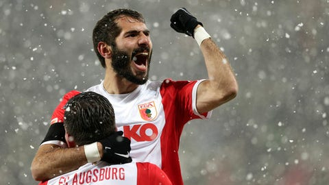 FILE- In this Sunday, Feb. 1, 2015 file photo, Augsburg's Halil Altintop from Turkey celebrates after scoring his side's opening goal during the German first division Bundesliga soccer match between FC Augsburg and TSG 1899 Hoffenheim in the SGL Arena in Augsburg, Germany. Czech champion Slavia Prague says it has signed a trio of experienced international midfielders: Portugal Danny, Turkey Halil Altintop and Ukraine Ruslan Rotan.  (AP Photo/Matthias Schrader, File)