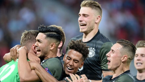 Germany goalkeeper Julian Pollersbeck, left, is congratulated by his teammates after saving the last shot of the penalty shootout during the Euro Under 21 semifinal soccer match between England and Germany in Tychy, Poland, Tuesday, June 27, 2017. (AP Photo/Alik Keplicz)