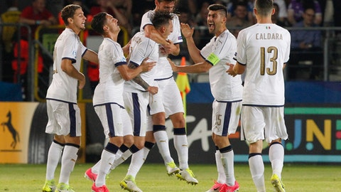 Italy's Federico Bernardeschi, 3rd from left, celebrates with teammates after scoring during the Euro Under 21 semifinal soccer match between Italy and Spain, at the Krakow Stadium, Poland, Tuesday, June 27, 2017. (AP Photo/Czarek Sokolowski)