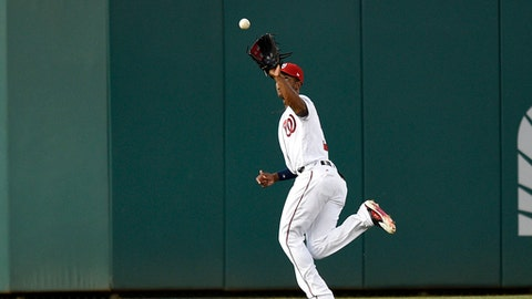 Washington Nationals center fielder Michael Taylor (3) makes a running catch on a fly ball by Chicago Cubs' Miguel Montero for the out during the fourth inning of a baseball game, Tuesday, June 27, 2017, in Washington. (AP Photo/Nick Wass)