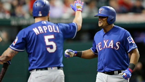 Texas Rangers' Adrian Beltre, right, is congratulated by Mike Napoli after Beltre hit a solo home run off Cleveland Indians relief pitcher Cody Allen in the ninth inning of a baseball game, Tuesday, June 27, 2017, in Cleveland. The Rangers won 2-1. (AP Photo/Tony Dejak)