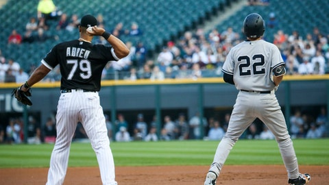 Chicago White Sox first baseman Jose Abreu (79) throws the ball after putting out New York Yankees' Jacoby Ellsbury (22) during the first inning of a baseball game Tuesday, June 27, 2017, in Chicago. (Armando L. Sanchez/Chicago Tribune via AP)