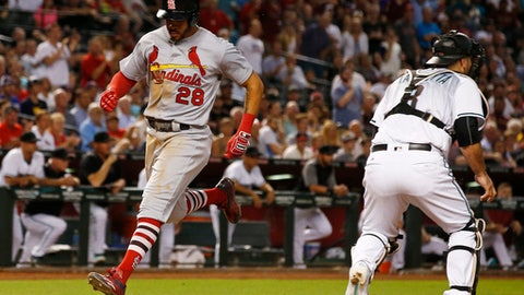 St. Louis Cardinals' Tommy Pham (28) scores as Arizona Diamondbacks' Chris Iannetta waits for a late throw during the seventh inning of a baseball game Tuesday, June 27, 2017, in Phoenix. (AP Photo/Ross D. Franklin)