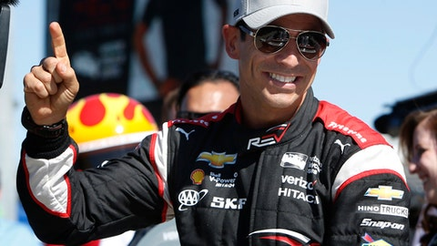 FILE - In this April 1, 2016, file photo, Helio Castroneves gestures after qualifying first for the IndyCar Phoenix Grand Prix auto race at Phoenix International Raceway in Avondale, Ariz. Chemistry on and off the track has helped fuel Team Penske's IndyCar success, with three-time Indianapolis 500 winner Castroneves setting the tone. (AP Photo/Rick Scuteri, File)