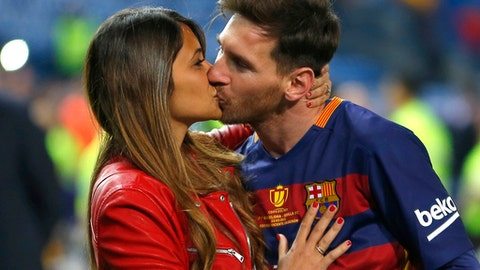 FILE - This is a Sunday, May 22, 2016  file photo of Barcelona's Lionel Messi, kisses his girlfriend Antonella Roccuzzo as they celebrate after winning the final of the Copa del Rey soccer match between FC Barcelona and Sevilla FC at the Vicente Calderon stadium in Madrid. Messi who will be the center of the attentions on Friday June 30, 2017  in his hometown of Rosario, Argentina,where he will be marrying 29-year-old Antonella Roccuzzo, his childhood friend and mother of his two children. (AP Photo/Francisco Seco/ File)