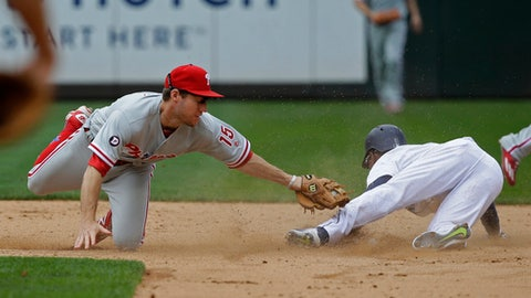 Seattle Mariners' Jarrod Dyson, right, steals second base as Philadelphia Phillies third baseman Ty Kelly attempts the tag during the sixth inning of a baseball game, Wednesday, June 28, 2017, in Seattle. (AP Photo/Ted S. Warren)