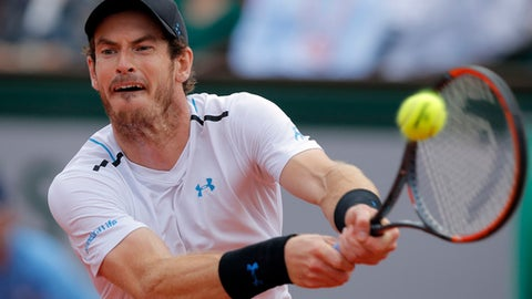 FILE - In this file photo dated Friday, June 9, 2017, Britain's Andy Murray in action against Switzerland's Stan Wawrinka during their semifinal match of the French Open tennis tournament at the Roland Garros stadium, in Paris.  Britain's top ranked Andy Murray has pulled out of another exhibition match scheduled for Friday June 30,  ahead of the upcoming Wimbledon championships, because of a sore hip, it is announced Thursday June 29, 2017. (AP Photo/Michel Euler, FILE)
