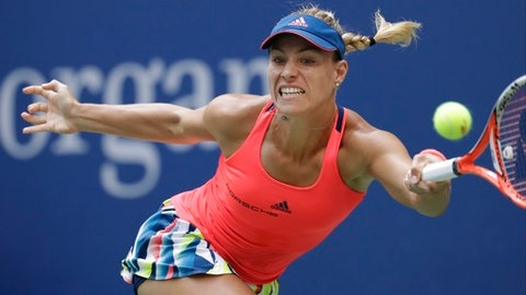 FILE - In this Sept. 10, 2016, file photo, Angelique Kerber, of Germany, returns a shot to Karolina Pliskova, of the Czech Republic, during the women's singles final of the U.S. Open tennis tournament, in New York. Kerber is the No. 1 seed women's player at Wimbledon, where play starts Monday. (AP Photo/Julio Cortez, File)