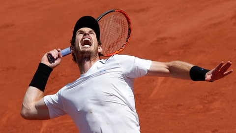 FILE - In this June 9, 2017, file photo, Britain's Andy Murray serves against Switzerland's Stan Wawrinka during their semifinal match of the French Open tennis tournament at Roland Garros stadium, in Paris. Murray's comfort level and crowd support at Wimbledon are both so strong that he can't be ruled out as a serious title contender. Play begins on Monday, July 3. (AP Photo/Christophe Ena, File)