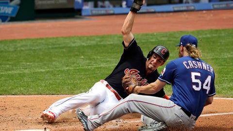 Cleveland Indians' Bradley Zimmer slides safely into home plate as Texas Rangers starting pitcher Andrew Cashner is late on the tag in the third inning of a baseball game, Thursday, June 29, 2017, in Cleveland. Zimmer scored on a a wild pitch by Cashner. (AP Photo/Tony Dejak)
