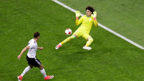 Mexico goalkeeper Guillermo Ochoa fails to save the ball as Germany's Leon Goretzka, left, scores his side's second goal during the Confederations Cup, semifinal soccer match between Germany and Mexico, at the Fisht Stadium in Sochi, Russia, Thursday, June 29, 2017. (AP Photo/Sergei Grits)