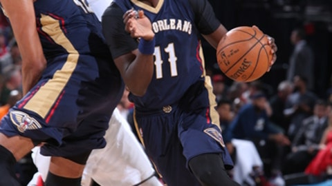 PORTLAND, OR - APRIL 12: Jrue Holiday #11 of the New Orleans Pelicans drives to the basket during the game against the Portland Trail Blazers on April 12, 2017 at the Moda Center in Portland, Oregon. NOTE TO USER: User expressly acknowledges and agrees that, by downloading and or using this Photograph, user is consenting to the terms and conditions of the Getty Images License Agreement. Mandatory Copyright Notice: Copyright 2017 NBAE (Photo by Sam Forencich/NBAE via Getty Images)