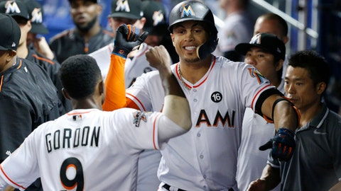 Miami Marlins' Giancarlo Stanton, right, and Dee Gordon (9) celebrate after Stanton hit a home run during the fourth inning of the team's baseball game against the New York Mets, Thursday, June 29, 2017, in Miami. (AP Photo/Wilfredo Lee)
