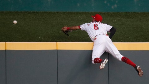 Cincinnati Reds center fielder Billy Hamilton cannot reach a three-run home run by Milwaukee Brewers' Jesus Aguilar during the fourth inning of a baseball game, Thursday, June 29, 2017, in Cincinnati. (AP Photo/John Minchillo)