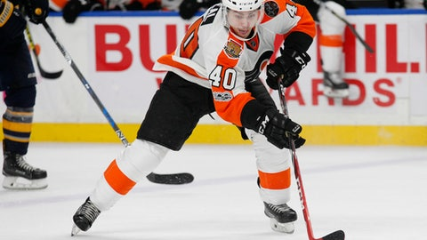 FILE - In this March 7, 2017, file photo, Philadelphia Flyers forward Jordan Weal (40) controls the puck during the team's NHL hockey game against the Buffalo Sabres in Buffalo, N.Y. The Flyers have re-signed Weal to a two-year deal. General manager Ron Hextall announced the deal Thursday night, June 29. Weal agreed to stay in Philadelphia, reaching a deal less than 48 hours before he would've become an unrestricted free agent. (AP Photo/Jeffrey T. Barnes, File)