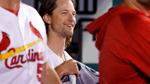 St. Louis Cardinals starting pitcher Mike Leake smiles in the dugout after coming off the field during the eighth inning of the team's baseball game against the Washington Nationals on Friday, June 30, 2017, in St. Louis. (AP Photo/Jeff Roberson)