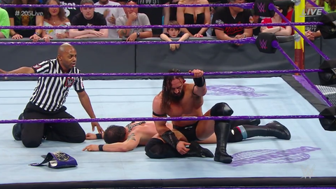 Neville defeated Austin Aries in a submission match to retain the Cruiserweight Championship