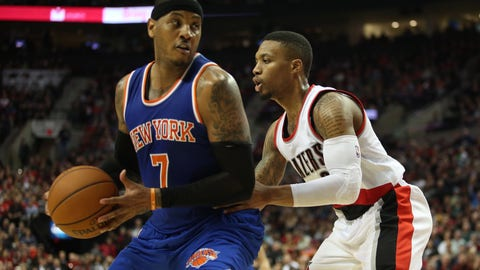 Dec 12, 2015; Portland, OR, USA;  Portland Trail Blazers guard Damian Lillard (0) defends New York Knicks forward Carmelo Anthony (7) at Moda Center at the Rose Quarter. Mandatory Credit: Jaime Valdez-USA TODAY Sports