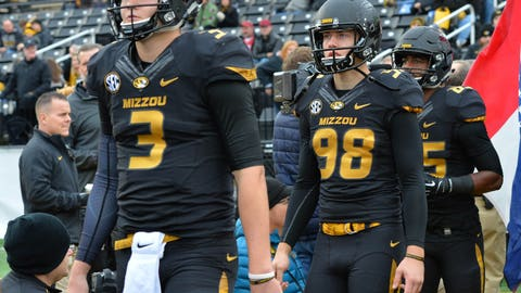 Nov 25, 2016; Columbia, MO, USA; Missouri Tigers quarterback Drew Lock (3) and place kicker Tucker McCann (98) enter the field on Senior Day before the game against the Arkansas Razorbacks at Faurot Field. Missouri won 28-24. Mandatory Credit: Denny Medley-USA TODAY Sports