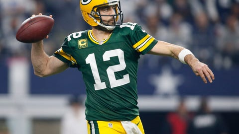 Jan 15, 2017; Arlington, TX, USA; Green Bay Packers quarterback Aaron Rodgers (12) throws a pass during the first quarter against the Dallas Cowboys in the NFC Divisional playoff game at AT&T Stadium. Mandatory Credit: Tim Heitman-USA TODAY Sports