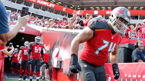 Jan 1, 2017; Tampa, FL, USA;  Tampa Bay Buccaneers offensive guard Ali Marpet (74) runs out of the tunnel before the game against the Carolina Panthers during the first half at Raymond James Stadium. Mandatory Credit: Kim Klement-USA TODAY Sports
