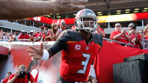 Jan 1, 2017; Tampa, FL, USA; Tampa Bay Buccaneers quarterback Jameis Winston (3) high fives fans as he runs out of the tunnel before the game against the Carolina Panthers at Raymond James Stadium. Mandatory Credit: Kim Klement-USA TODAY Sports