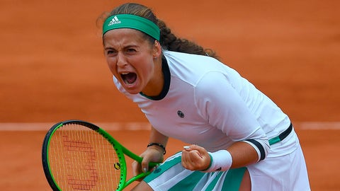 Latvia's Jelena Ostapenko reacts after scoring during her tennis match against Denmark's Caroline Wozniacki at the Roland Garros 2017 French Open on June 6, 2017 in Paris.  / AFP PHOTO / GABRIEL BOUYS        (Photo credit should read GABRIEL BOUYS/AFP/Getty Images)